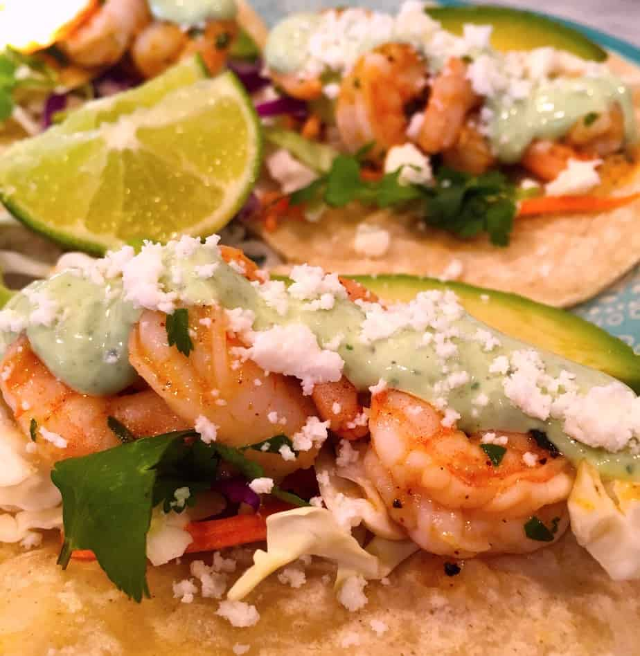 tacos made with shrimp,cabbage, cilantro and a special sauce