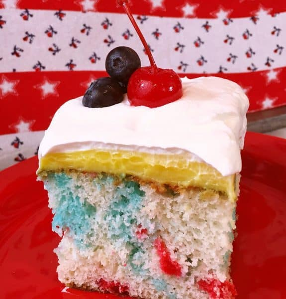 slice of red, white, and blue poke cake