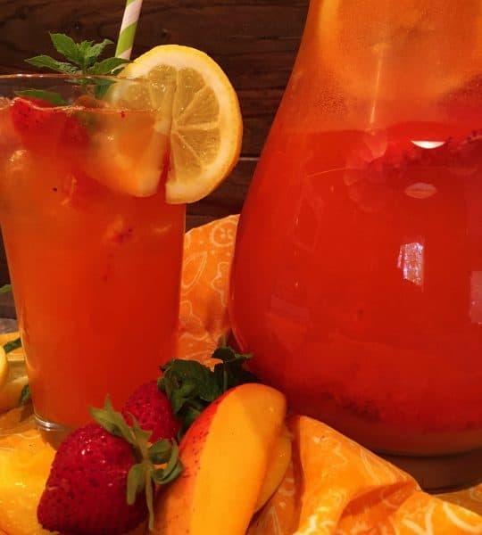 Glass full of Sparkling Strawberry Mango Lemonade
