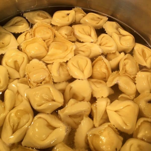 Tortellini cooking in large pot