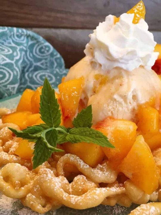 Funnel cake with peaches and cream