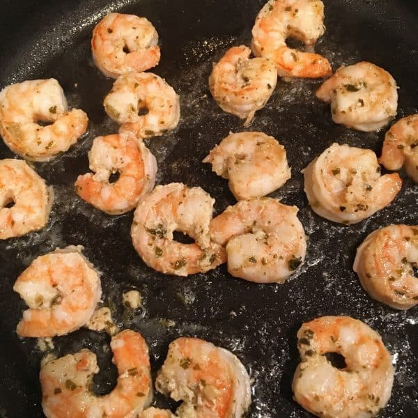 Shrimp cooking in a hot skillet