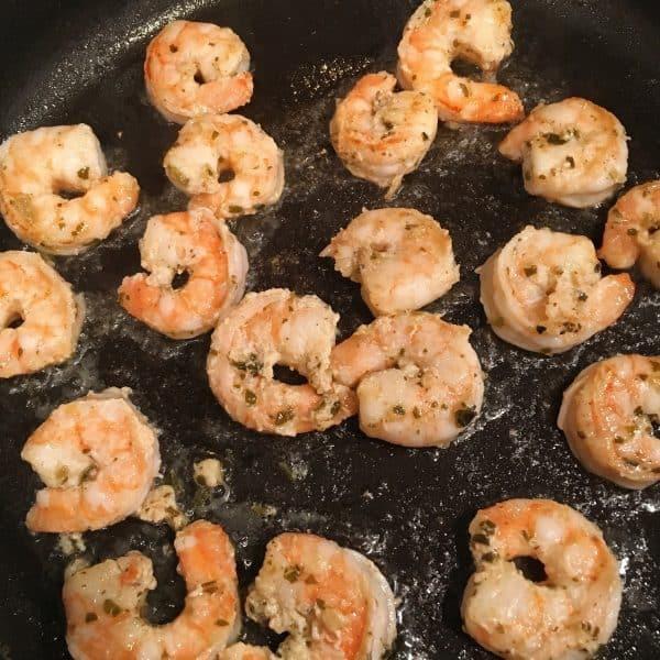 Shrimp cooking in a hot skillet