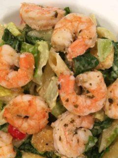 A cesar salad with shrimp