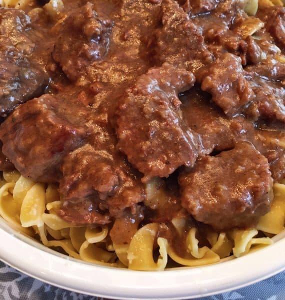 Beef and gravy over Parmesan Egg Noodles