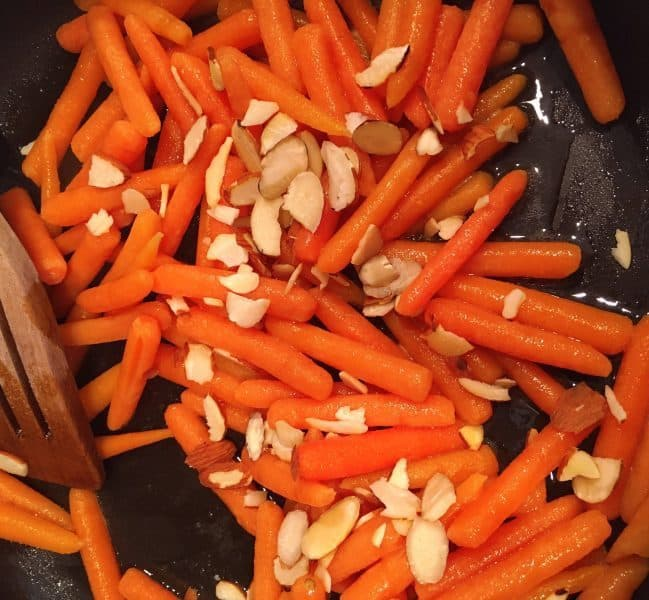 adding slivered almonds to sauteed carrots
