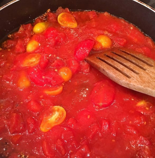 skillet full of tomato sauce ingredients
