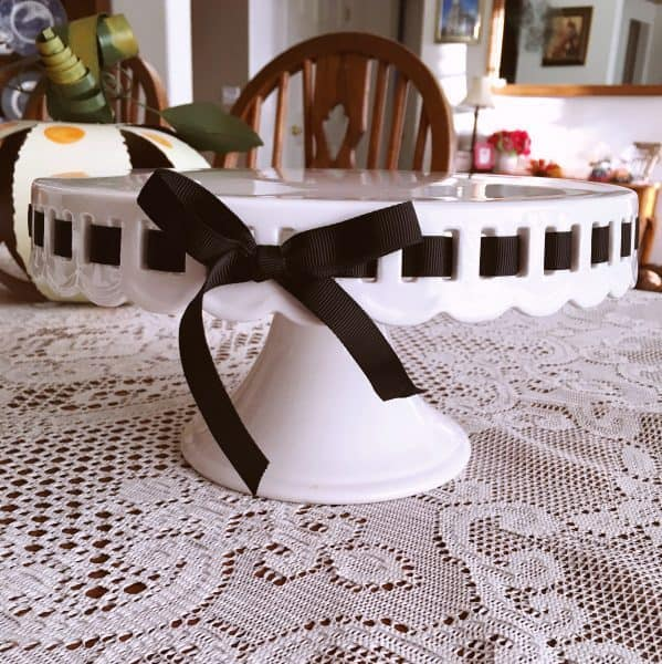 cake plate with black ribbon