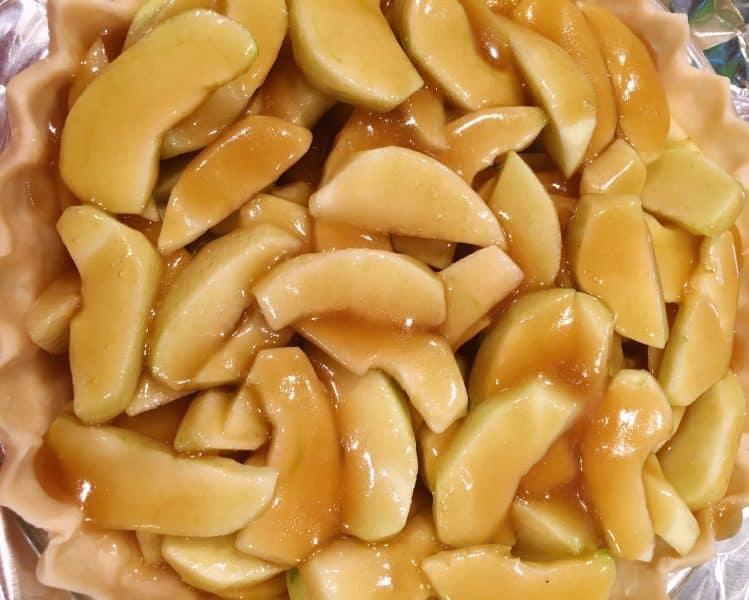 caramel sauce poured over slicing apples