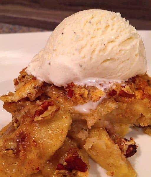 Apple Pecan Cobbler topped with vanilla ice cream