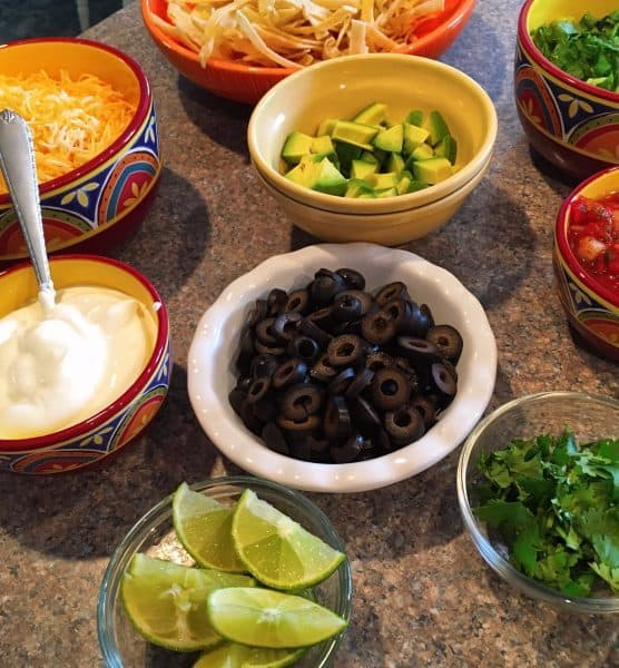 Taco topping bar...olives, avocados, cheese, sour cream, chips and more