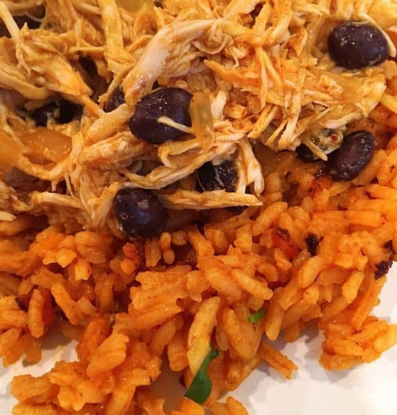 building a Mexican haystack. Rice, Chicken and beans.