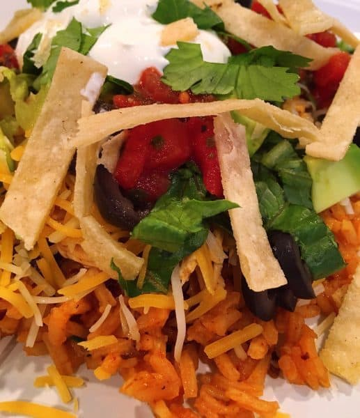 Mexican Haystacks with Spanish Rice at the base