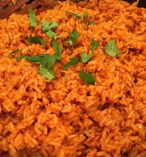 Pan full of fluffy Spanish Rice with chopped cilantro