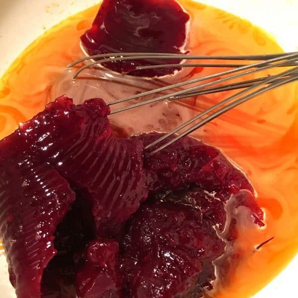 adding cranberry sauce to orange jello
