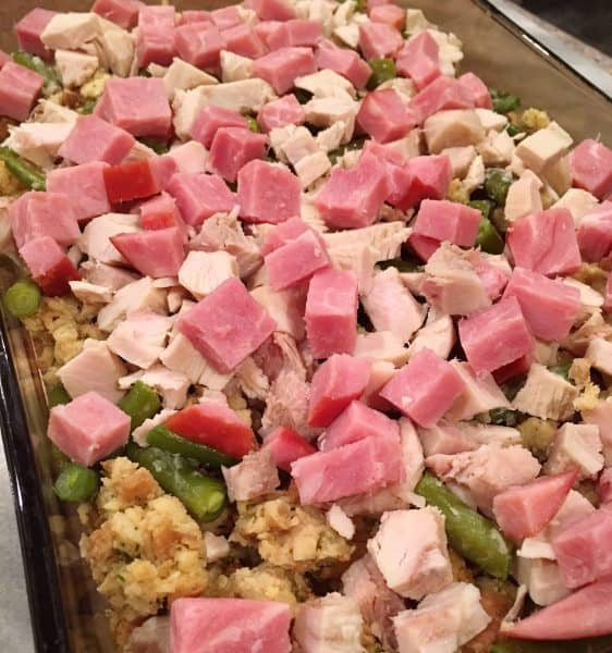 Left over diced ham and turkey on top of stuffing and veggies