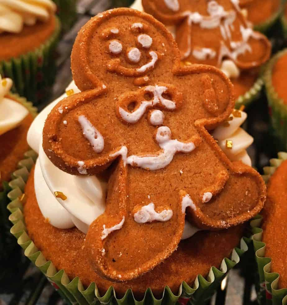 A cupcake with a gingerbread man on top