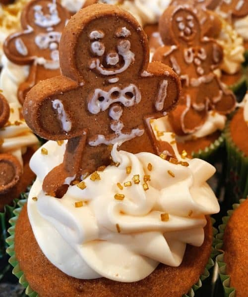 gingerbread man cookie on top of ginger ale spiced cupcakes