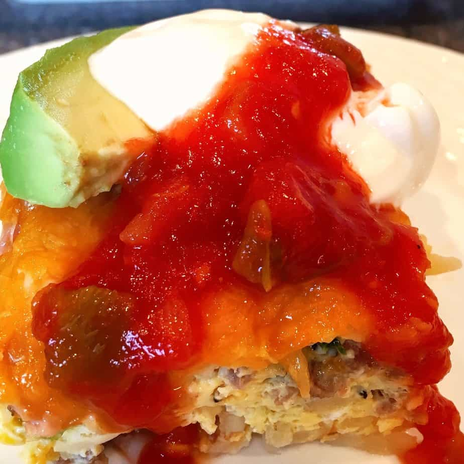 An egg casserole with cheese sour cream and avocado
