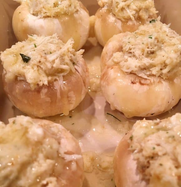 Melted butter over the top of stuffed mushrooms