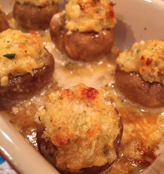 Stuffed Crab Mushrooms baked to a golden crisp in a small casserole dish