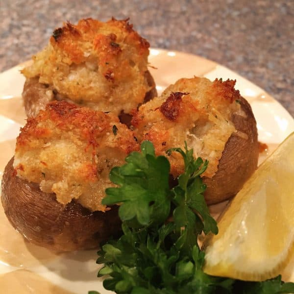 Crab Stuffed Mushrooms on a plate ready to eat.