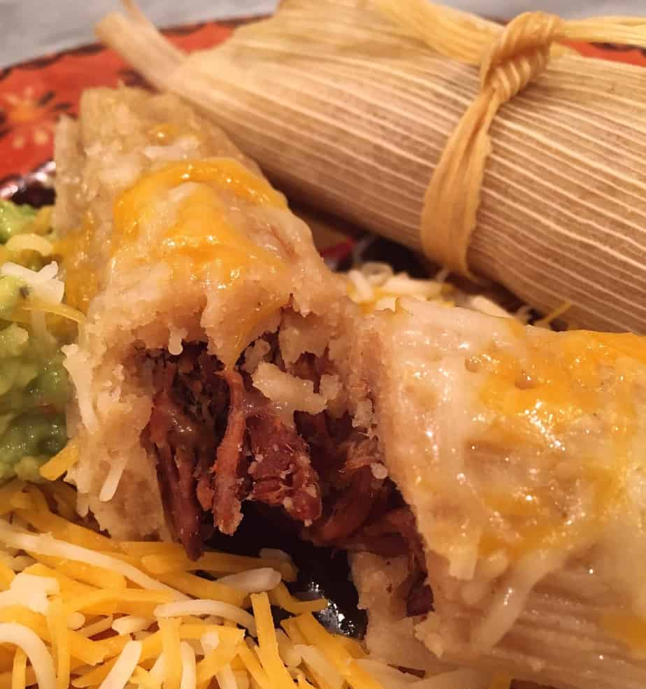 Homemade tamales with cheese on top