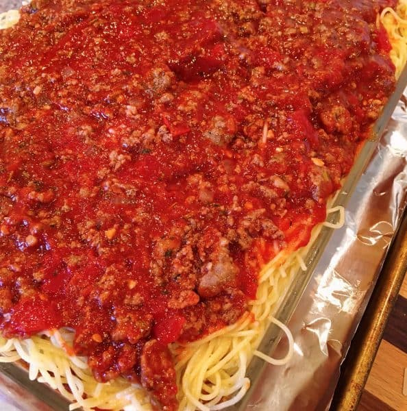 Last layer of meat sauce on top of spaghetti for Baked Spaghetti