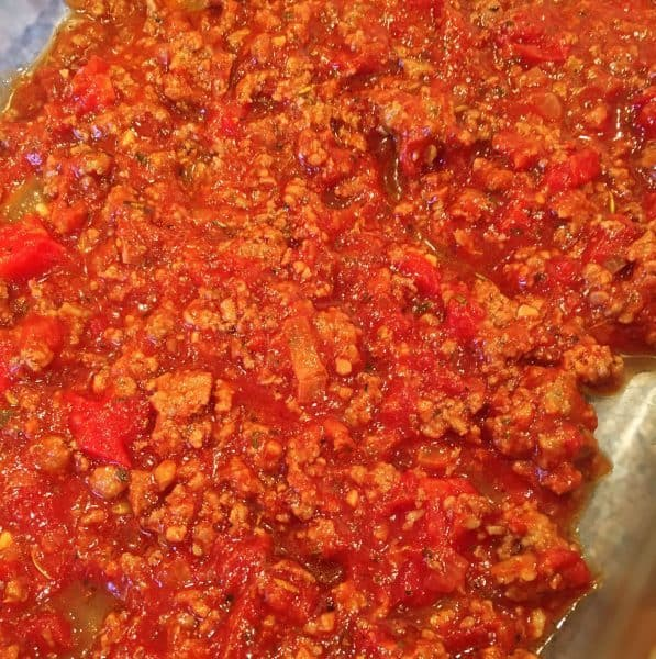 Meat sauce layering in the bottom of the casserole dish