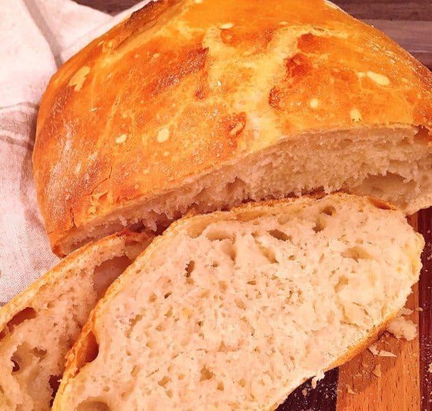 No knead Artisan Bread sliced on cutting board