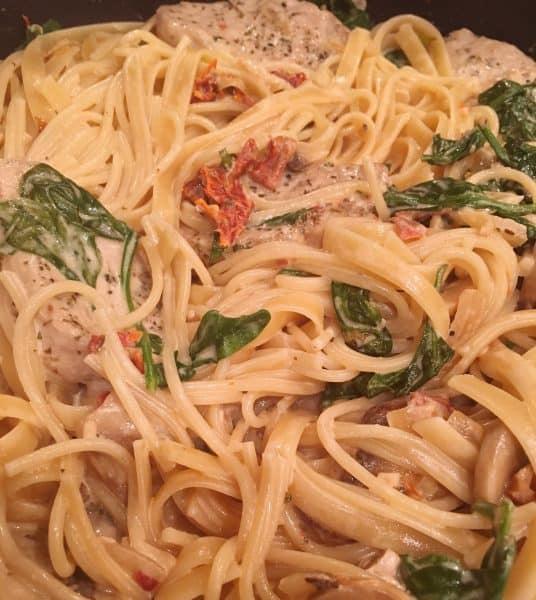 pasta, pork medallions, and cream sauce together