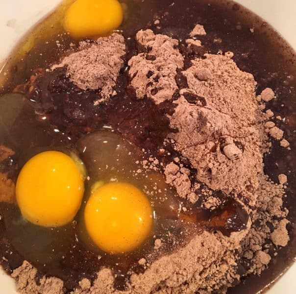Brownie mix, eggs, and oil in a bowl ready to mix.
