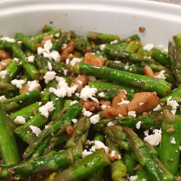 Chopped Sauteed Asparagus with toasted walnuts and sprinkled with feta cheese