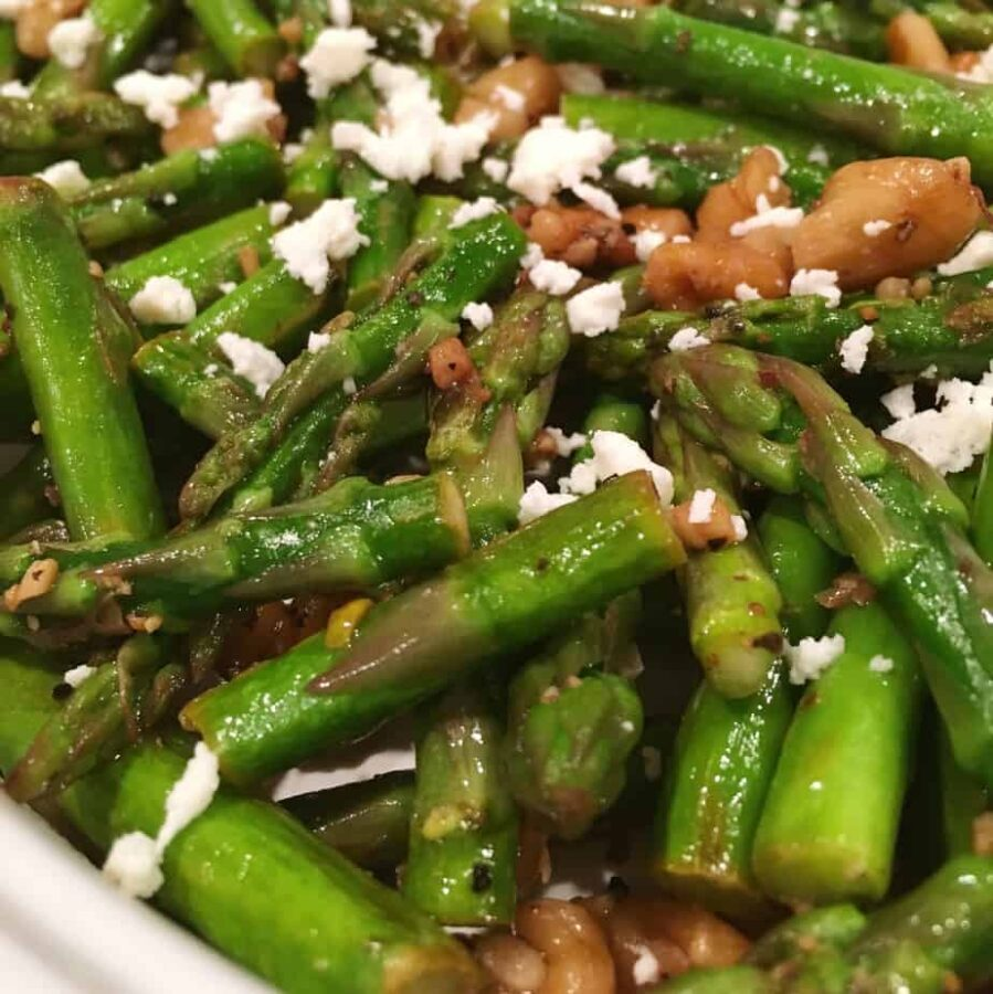 Chopped Asparagus sauteed in walnut oil and topped with chopped toasted walnuts and sprinkled with Feta Cheese