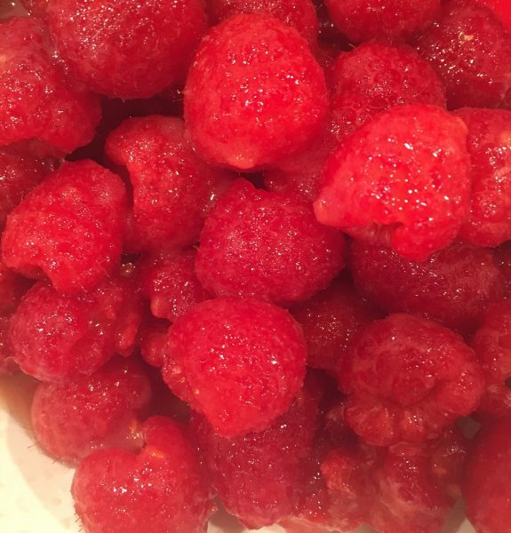 Fresh Raspberries, sugar, and apple juice all mixed together