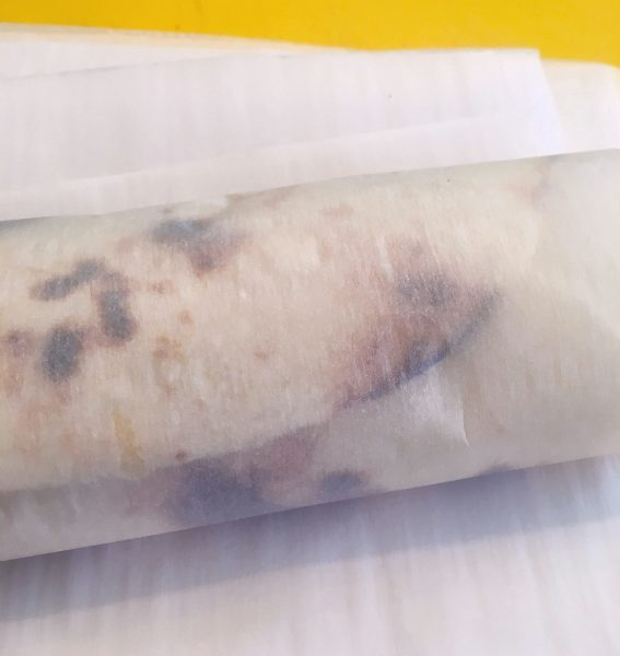 Breakfast Burrito wrapped in parchment paper