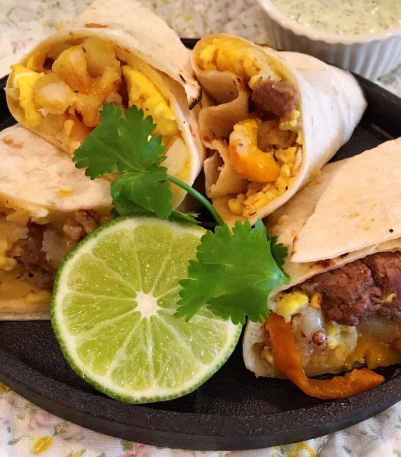 Plate full of heated breakfast burritos
