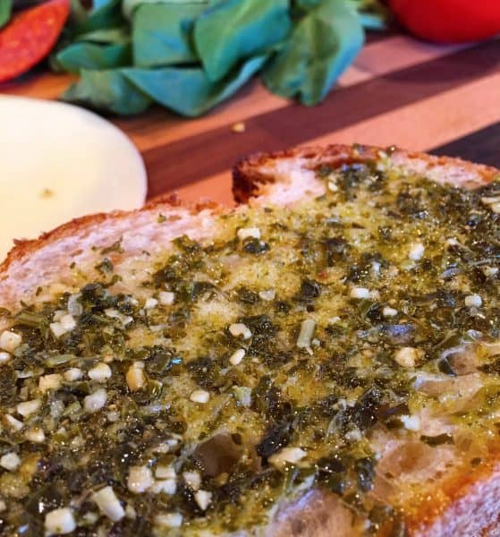 Slice of bread of Pesto spread on it.