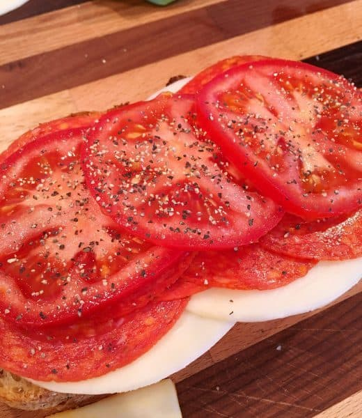 Italian Grilled Cheese Preparation with layer of fresh tomatoes
