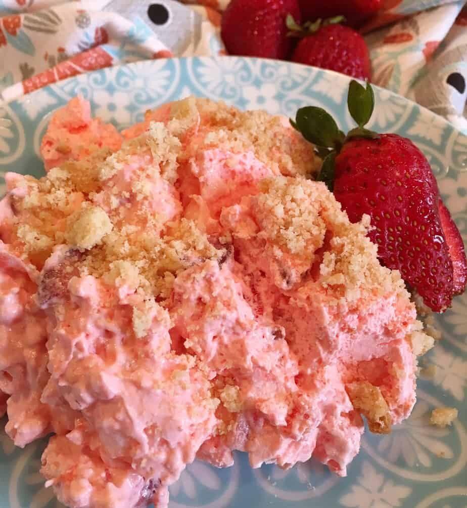 Serving of Strawberry Pineapple Fluff Jello Salad on Teal Plate