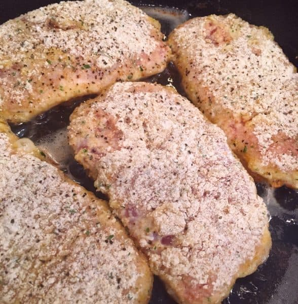 Fry pan with Olive Oil and Coated Pork Chops