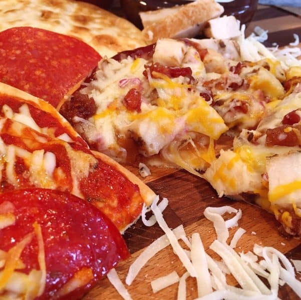 Slices of Pepperoni and BBQ Chicken Personal Pan Flat Bread Pizzas