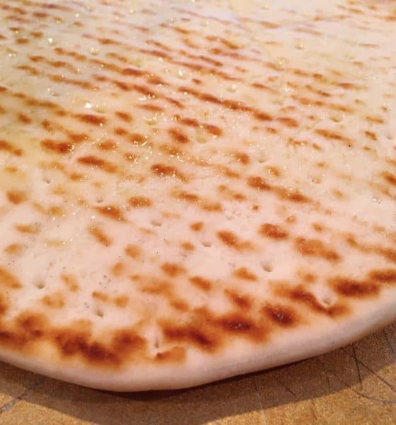 Bottom of Flat Bread Brushed with Olive Oil