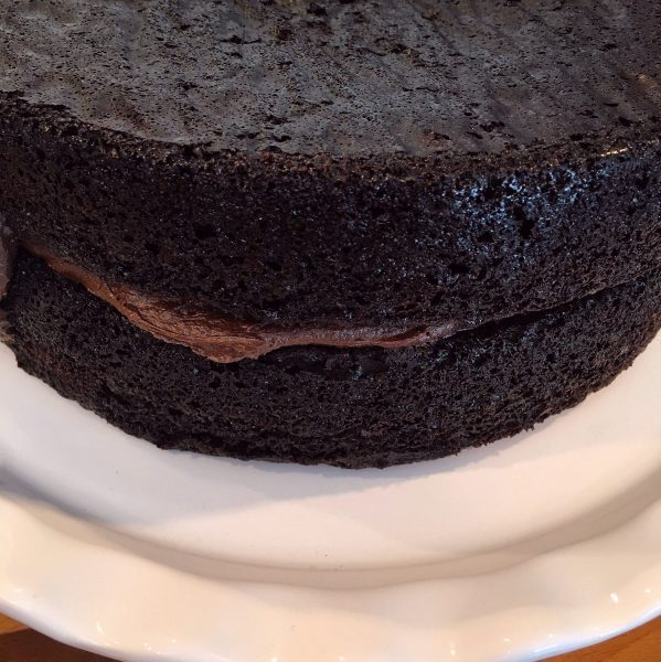 Best Dark Chocolate Cake being frosted