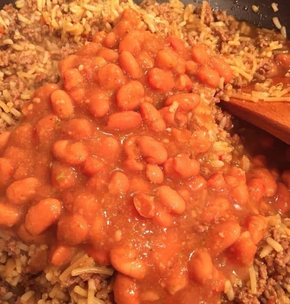 Adding Pinto Beans to meat and rice mixture