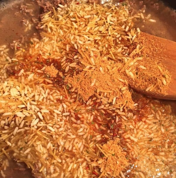 Adding one package of Knorr Taco Rice