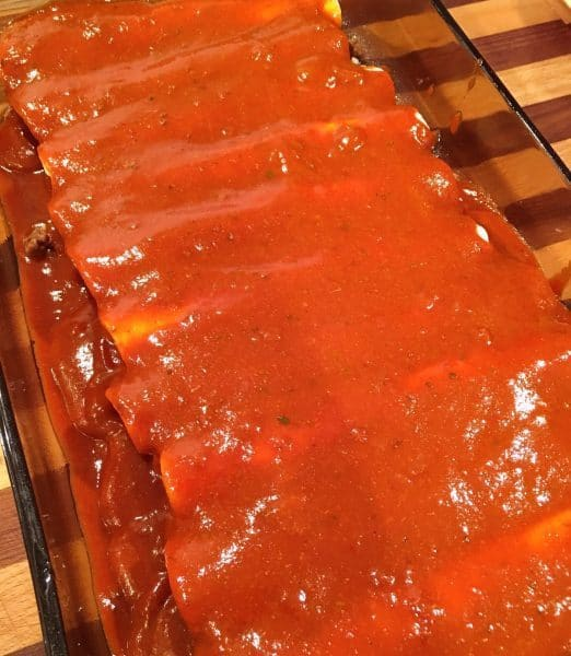 Easy Ground Beef Enchiladas covered in sauce