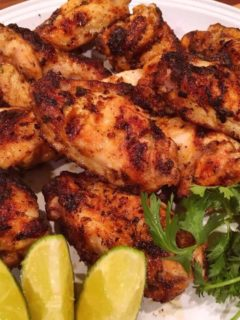 Grilled wings on plate