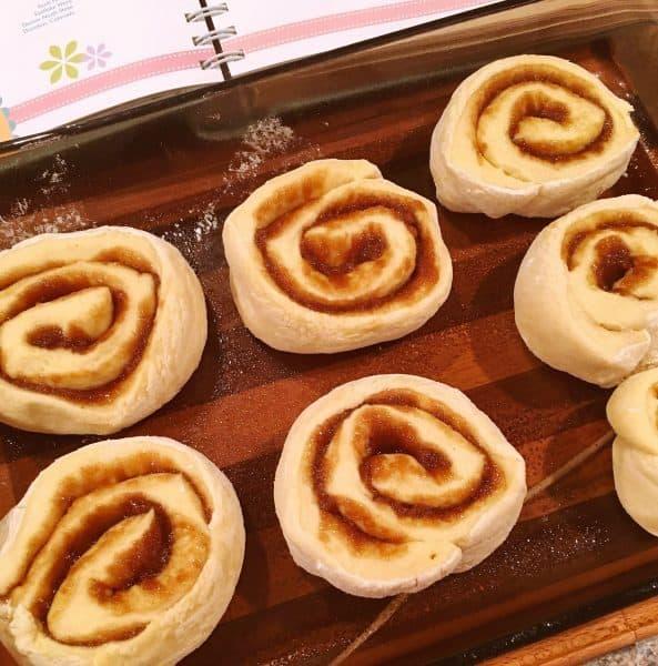 Cut Cinnamon Roll Dough in glass baking dish