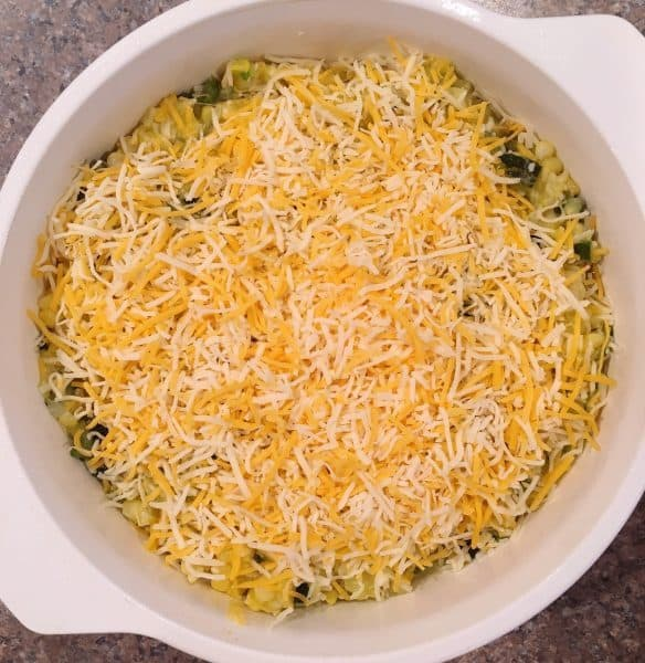 Green and Gold Squash Casserole topped off with cheese